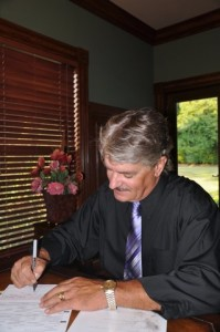Rande Banks Signing Marriage Certificate